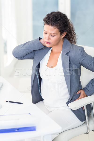 Fáradt terhes üzletasszony ül szék iroda Stock fotó © wavebreak_media
