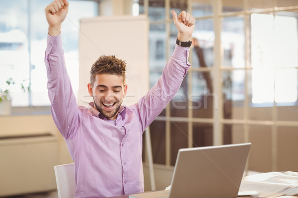 Happy businessman with arms raised Stock photo © wavebreak_media