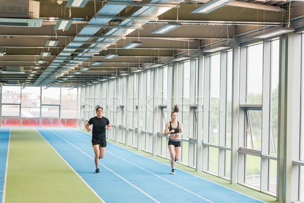 Couple running on the indoor track Stock photo © wavebreak_media