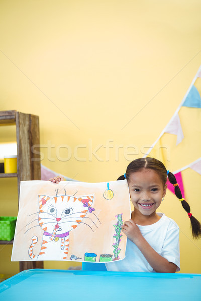 Smiling girl with a painting of her cat Stock photo © wavebreak_media