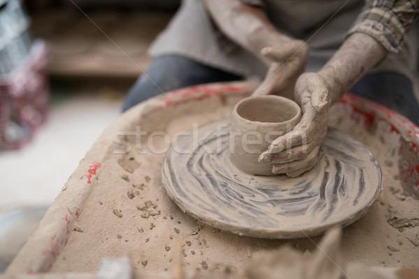Mid section of male potter molding clay Stock photo © wavebreak_media