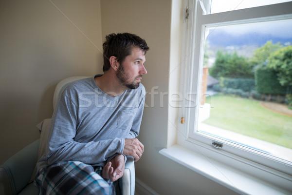 Man looking through the window Stock photo © wavebreak_media