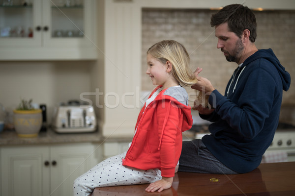 Father making daughters hairstyle Stock photo © wavebreak_media
