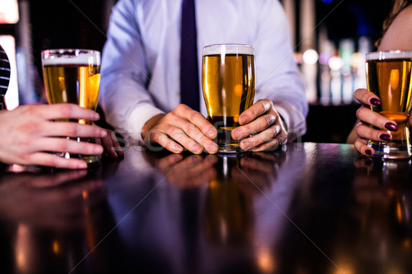 Friends having a beer  Stock photo © wavebreak_media