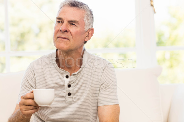 Thoughtful senior man holding mug Stock photo © wavebreak_media
