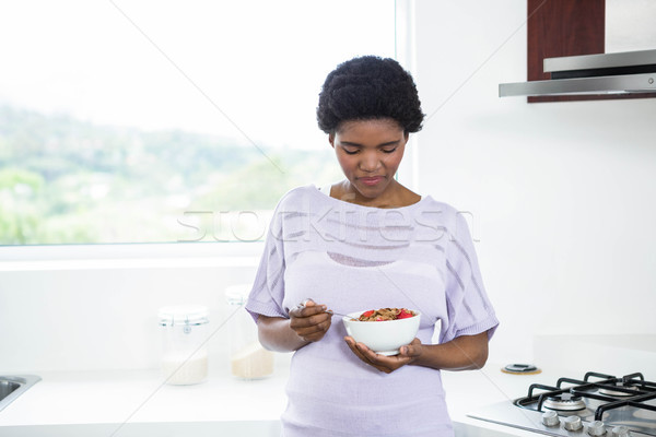 Pregnant woman eating cereal Stock photo © wavebreak_media