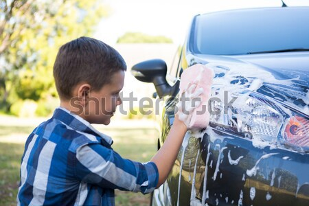 Auto service staff cleaning a car with duster Stock photo © wavebreak_media