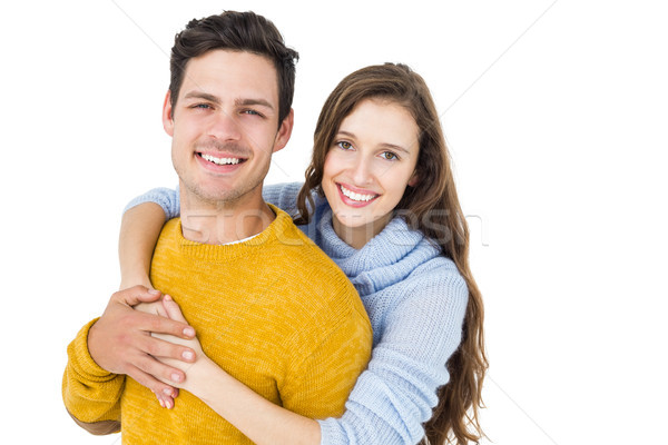 Happy couple embracing and looking camera Stock photo © wavebreak_media
