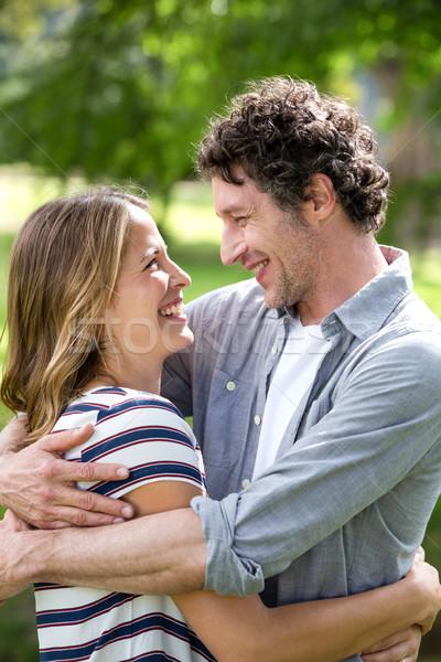 Smiling couple embracing in park Stock photo © wavebreak_media