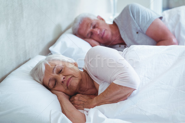 Senior couple sleeping on bed  Stock photo © wavebreak_media