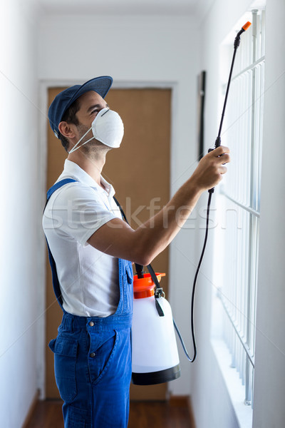 Side view of worker using pesticide Stock photo © wavebreak_media