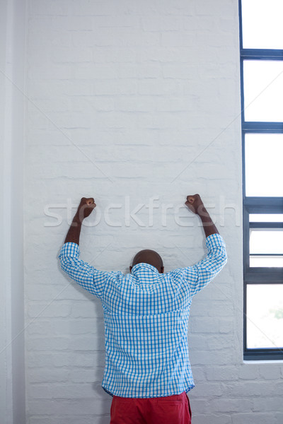 Upset man leaning against wall Stock photo © wavebreak_media