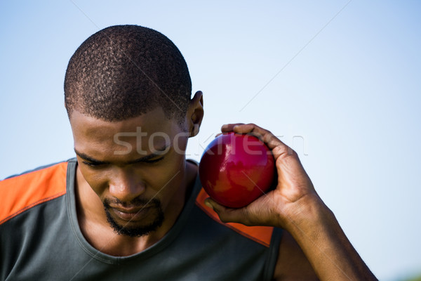 Stock photo: Male athlete holding shot put ball
