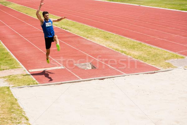 選手 長い ジャンプ 男 フィールド ストックフォト © wavebreak_media