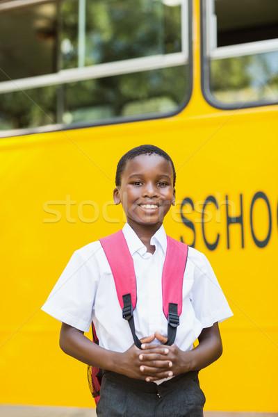 Souriant écolier permanent bus scolaire portrait heureux Photo stock © wavebreak_media