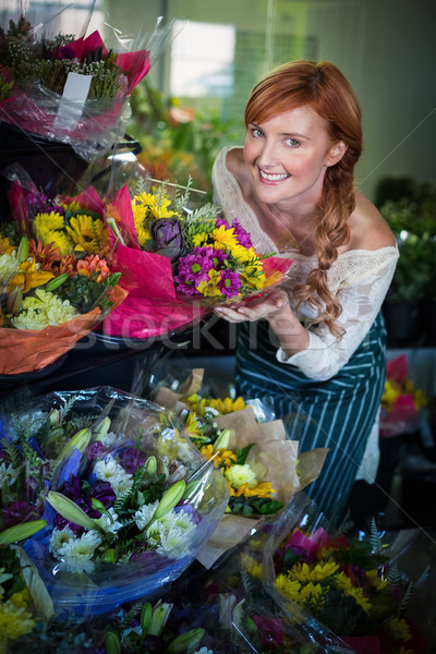 Female florist touching flower bouquet Stock photo © wavebreak_media