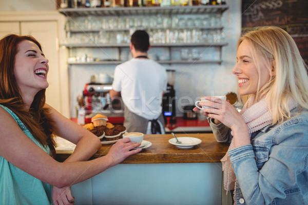 Cheerful customers talking at counter in coffee shop Stock photo © wavebreak_media