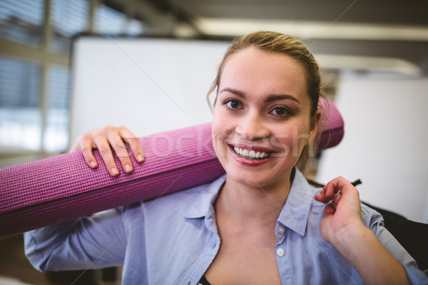 Happy businesswoman with bag and exercise mat Stock photo © wavebreak_media