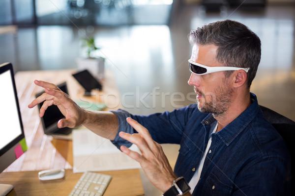 Man wearing virtual reality glass Stock photo © wavebreak_media