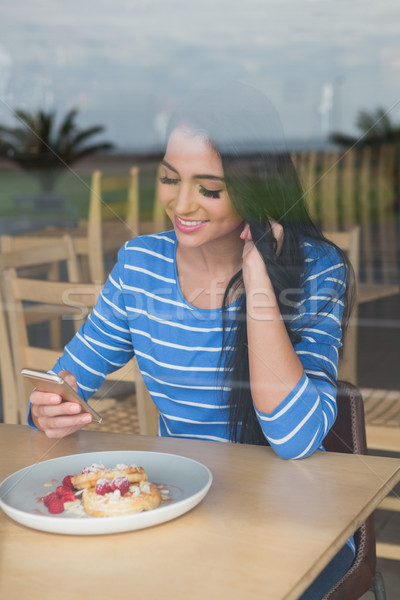 Woman text messaging on mobile phone Stock photo © wavebreak_media