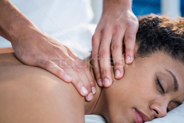 Mulher pescoço massagem bebê homem de volta Foto stock © wavebreak_media