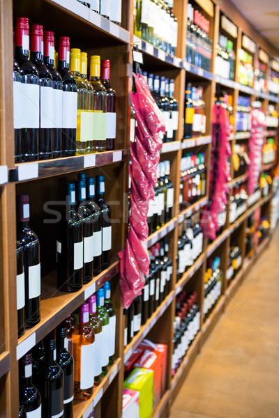 Variété vin bouteilles épicerie supermarché Photo stock © wavebreak_media