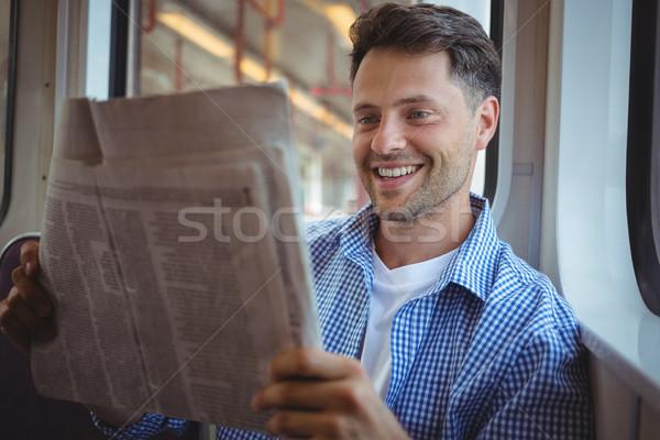 Jóképű férfi olvas újság vonat szeretet férfi Stock fotó © wavebreak_media