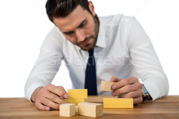Businessman placing wooden block on a tower Stock photo © wavebreak_media