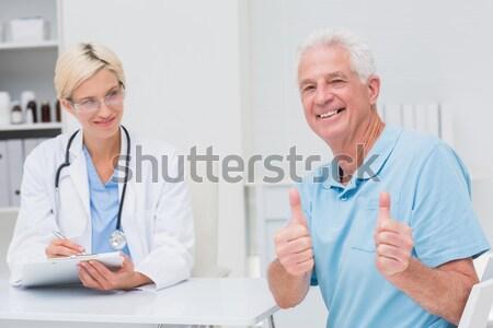 Foto stock: Cirurgião · médico · outro · clínica · homem · feliz