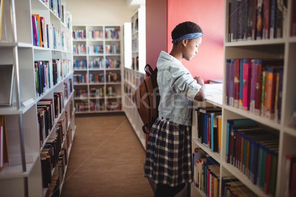 özenli öğrenci okuma kitap kütüphane okul Stok fotoğraf © wavebreak_media