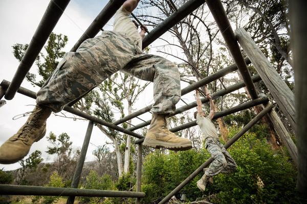 Soldiers climbing monkey bars Stock photo © wavebreak_media