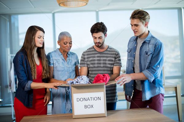 Criador equipe de negócios roupa doação caixa escritório Foto stock © wavebreak_media