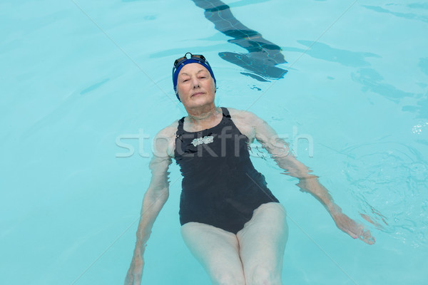 Senior woman swimming in pool Stock photo © wavebreak_media