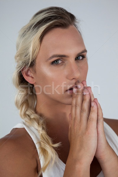 Portrait of transgender woman with hands clasped Stock photo © wavebreak_media
