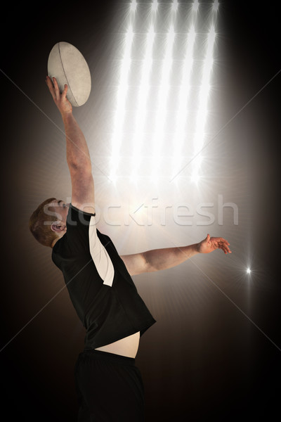 Composite image of rugby player catching a rugby ball Stock photo © wavebreak_media