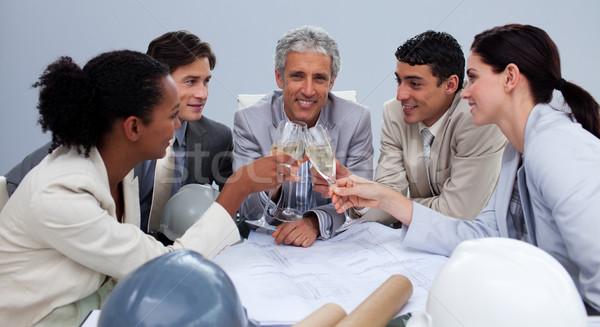 Heureux équipe célébration champagne bureau femme Photo stock © wavebreak_media
