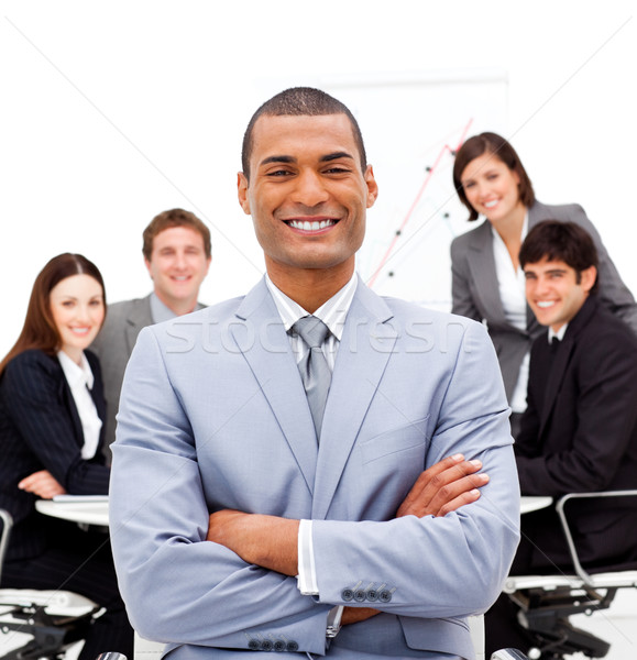 Smiling male executive with folded arms sitting in front of his  Stock photo © wavebreak_media