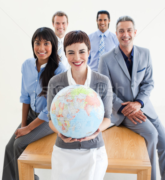 Cheerful multi-ethnic business people holding a terrestrial glob Stock photo © wavebreak_media