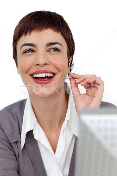 Risonho empresária fone branco escritório cara Foto stock © wavebreak_media