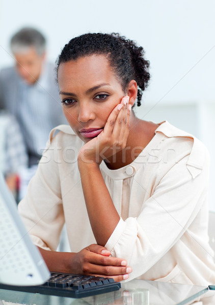 Stock photo: Bored businesswoman at her desk