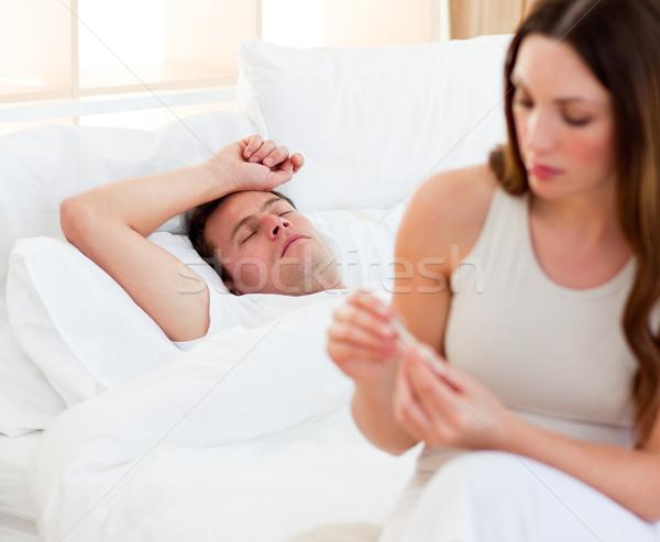 женщину больным температура спальня домой Сток-фото © wavebreak_media