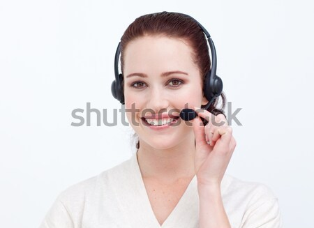 Atraente empresária fone sorridente câmera escritório Foto stock © wavebreak_media
