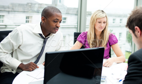 Multi-ethnic business team interacting with each other Stock photo © wavebreak_media