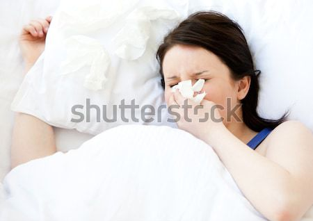 Radiant woman relaxing lying on her bed Stock photo © wavebreak_media