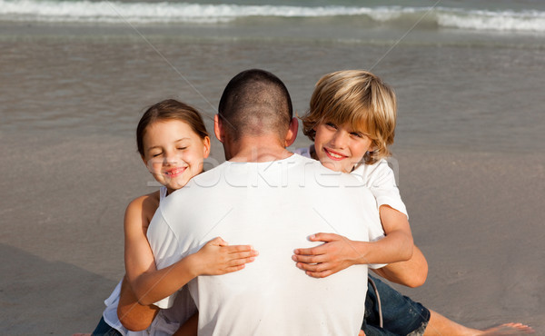 Father with his two children on the beach Stock photo © wavebreak_media