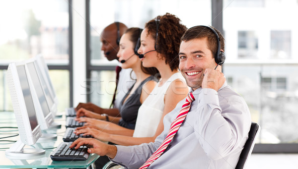 Young businessman working in a call center smiling at the camera Stock photo © wavebreak_media