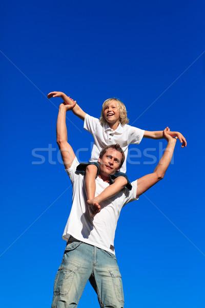 男 ピギーバック 笑みを浮かべて 屋外 笑顔 ストックフォト © wavebreak_media