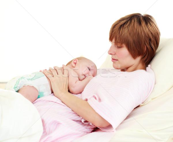 Patient looking at her newborn baby in bed Stock photo © wavebreak_media