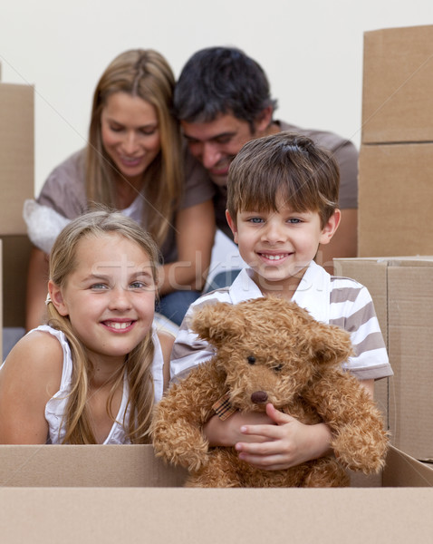 Little boy and girl moving house with parents Stock photo © wavebreak_media
