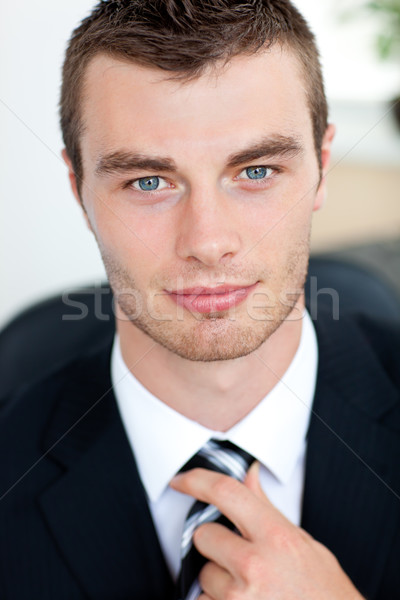 Stock photo: Attractive businessman smiling at camera in office